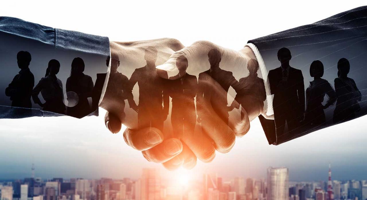 Convenios colectivos. Imagen del saludo de dos manos